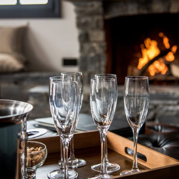 Sitting Room With Fire And Champagne In Luxury Ski Chalet Tomkins In Meribel